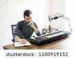 hispanic male songwriter... | Shutterstock . vector #1100919152