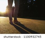 girl walk in the city at... | Shutterstock . vector #1100932745