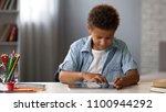little clever kid swiping... | Shutterstock . vector #1100944292