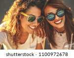 two female friends hangout at...   Shutterstock . vector #1100972678