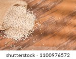 white seeds of quinoa in the... | Shutterstock . vector #1100976572