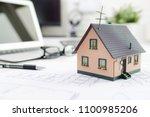 house model on desk  mortgage ...   Shutterstock . vector #1100985206