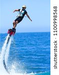 man flyboarding on  the sea of... | Shutterstock . vector #1100998568