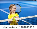 child playing tennis on indoor... | Shutterstock . vector #1101015152