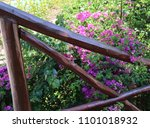 a wooden railing in a tropical... | Shutterstock . vector #1101018932