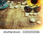 beach accessories on wooden | Shutterstock . vector #1101032336