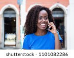 woman from africa talking at...   Shutterstock . vector #1101082286