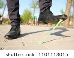man stepping in chewing gum on...   Shutterstock . vector #1101113015