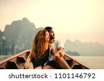 couple boating on a quiet lake | Shutterstock . vector #1101146792
