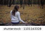 sad woman sitting in autumn... | Shutterstock . vector #1101163328