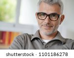 portrait of smiling middle aged ... | Shutterstock . vector #1101186278