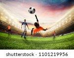 soccer striker hits the ball... | Shutterstock . vector #1101219956