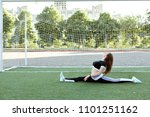 young woman in sports clothes... | Shutterstock . vector #1101251162