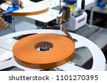 the plastic edge mill is fed... | Shutterstock . vector #1101270395