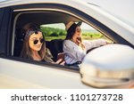 two girls driving in the car.... | Shutterstock . vector #1101273728