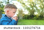 little boy sneezing with tissue ... | Shutterstock . vector #1101276716
