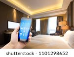 Stock photo smart phone with smart modern home 1101298652