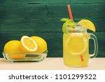 mason jar glass of lemon... | Shutterstock . vector #1101299522