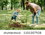 father looking how son planting ... | Shutterstock . vector #1101307928