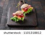 mini sandwiches with lettuce ... | Shutterstock . vector #1101318812