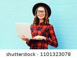 stylish happy woman using... | Shutterstock . vector #1101323078