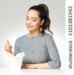 portrait of a brunette beauty... | Shutterstock . vector #1101381542