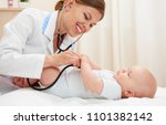 smiling female pediatrician... | Shutterstock . vector #1101382142