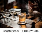 bartender decorating fresh and... | Shutterstock . vector #1101394088