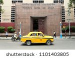 a yellow taxi moves in front of ... | Shutterstock . vector #1101403805