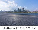 asphalt road with city skyline... | Shutterstock . vector #1101474185