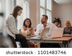 co workers talking though...   Shutterstock . vector #1101483746