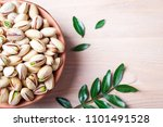 pistachios nuts in bowl.... | Shutterstock . vector #1101491528