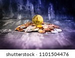 Small photo of Golden EOS.IO and mound of money. Digital cryptocurrency concept