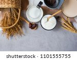 yogurt and milk on a table with ...   Shutterstock . vector #1101555755