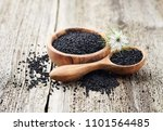 black cumin oil with flower on... | Shutterstock . vector #1101564485