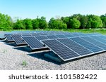 large solar panels in a wooded... | Shutterstock . vector #1101582422