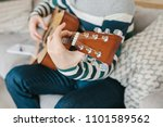 learning to play the guitar.... | Shutterstock . vector #1101589562