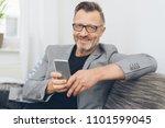 portrait of smiling mature man... | Shutterstock . vector #1101599045