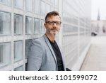 pensive middle aged businessman ... | Shutterstock . vector #1101599072