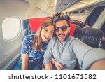 happy couple traveling around... | Shutterstock . vector #1101671582