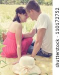 Romantic young couple resting on the Glade - stock photo