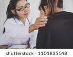 asian female doctor comforting... | Shutterstock . vector #1101835148