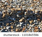 baltic sea stone beach. | Shutterstock . vector #1101865586