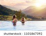 kids play in outdoor infinity... | Shutterstock . vector #1101867392