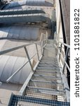 Small photo of Metal galvanized staircase with grate.