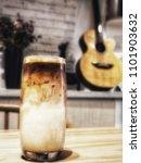 glass of ice milk coffee...   Shutterstock . vector #1101903632