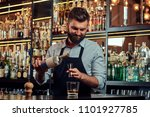 stylish brutal barman in a... | Shutterstock . vector #1101927785