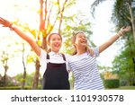 two asian teenager laughing... | Shutterstock . vector #1101930578