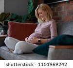 beautiful pregnant caucasian... | Shutterstock . vector #1101969242