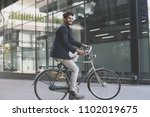 businessman driving  bike.... | Shutterstock . vector #1102019675